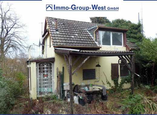 Kleines Einfamilienhaus mit großem Grundstück