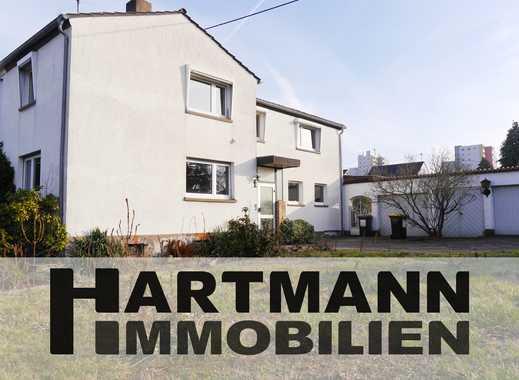 Wandlungsfähiges Einfamilienhaus mit großer Garagenanlage!