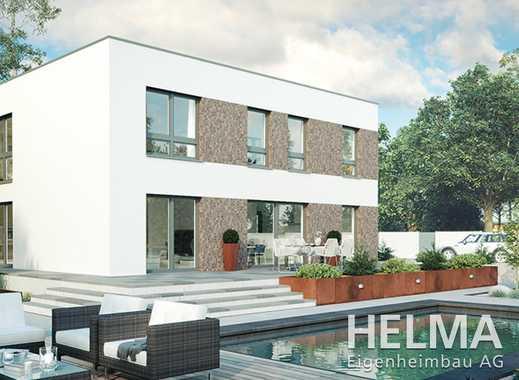 Moderne Stadtvilla mit Flachdach und viel Platz!