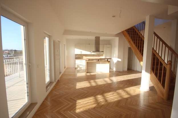Wohnzimmer mit EBK