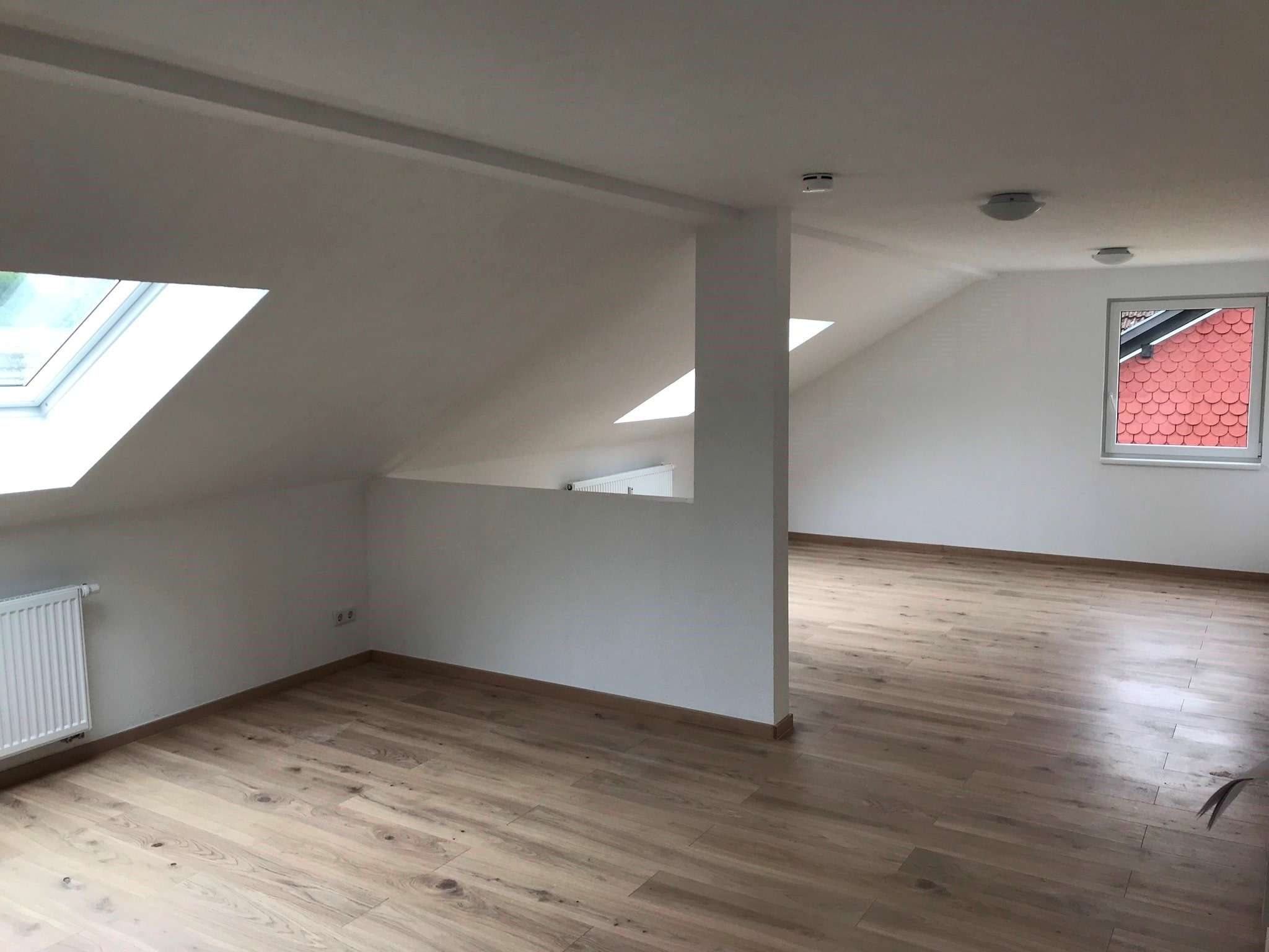 Erstbezug nach Sanierung - helle Dachgeschosswohnung in