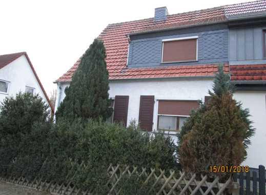 Doppelhaushälfte mit Grundstück, Garage und Nebengelass zu verkaufen