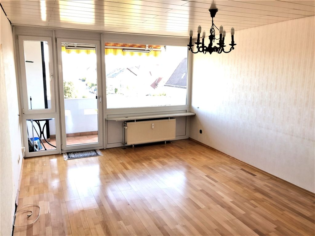 Wohnzimmer mit Balkon Markise
