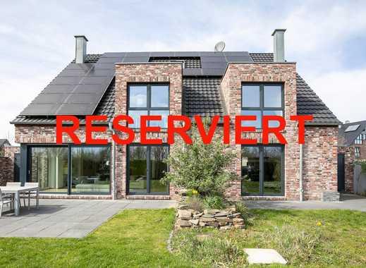 Neuss-Grmilinghausen in Rheinnähe: Freistehendes luxuriöses Einfamilienhaus mit Einliegerwohnung