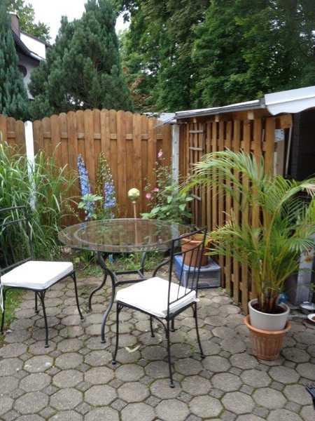 GAUTING-Außergewöhnliche Souterrainwohnung mit Gartennutzung ca. 62 qm - auch kpl. möbliert möglich in Gauting