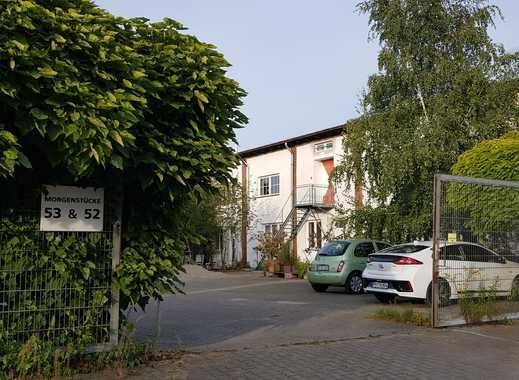 Erstbezug - 3-Zimmer-Wohnung mit Terrasse und Gartenanteil im 3-Seiten-Hof