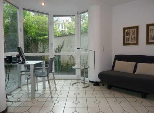 Idealer Zweitwohnsitz: Möbliertes 1-Zimmer-Komfort-Apt. mit begrüntem Patio in Top-Innenstadtlage