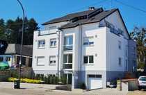 Neuwertiges Souterrain-Appartement mit geräumiger Terrasse