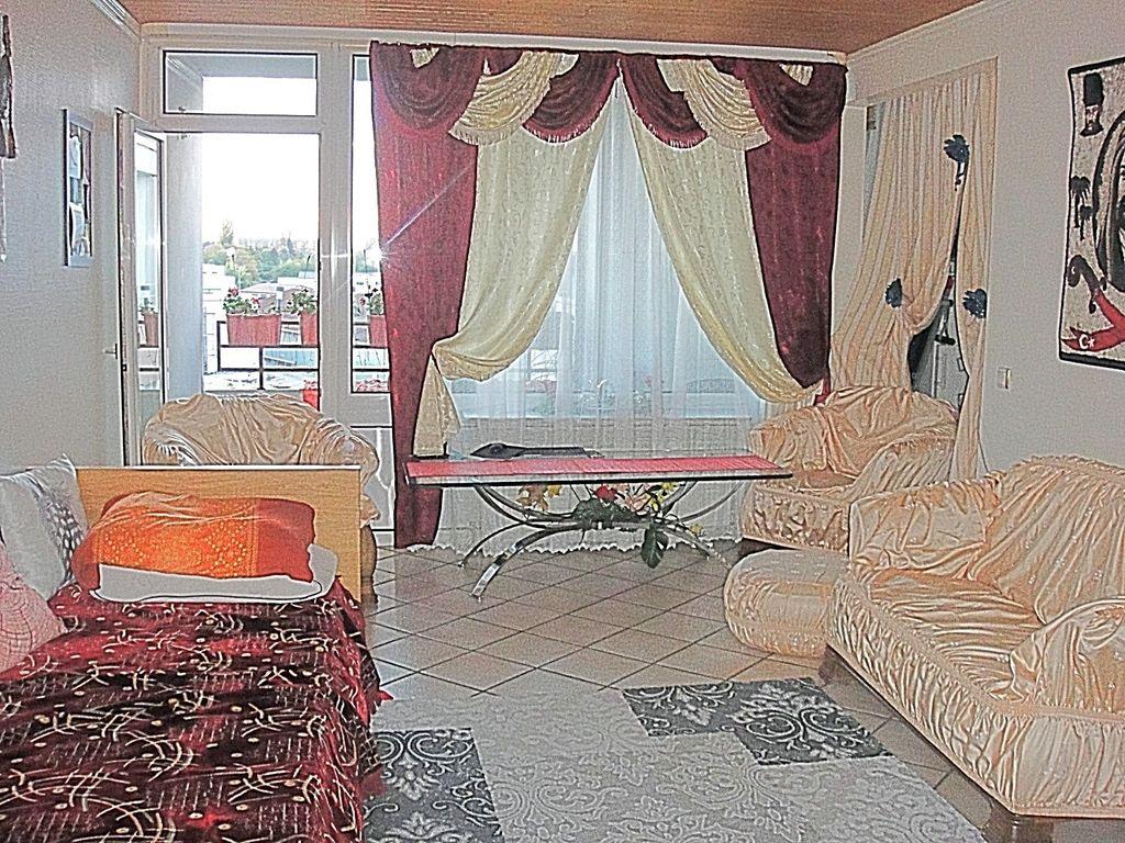 Wohnzimmer Balkon-Seite