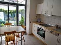 Möblierte 2 5-Zimmer-Erdgeschosswohnung mit Terrasse