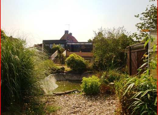 Freistehender Bungalow mit idyllischem Garten und Altbau als Einliegerwohnung