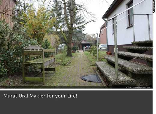 Hochwertiges Ein-bis Zweifamilienhaus mit parkähnlichem Grundstück