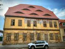 denkmalgeschütztes Mehrfamilienhaus in Zentrumslage sucht