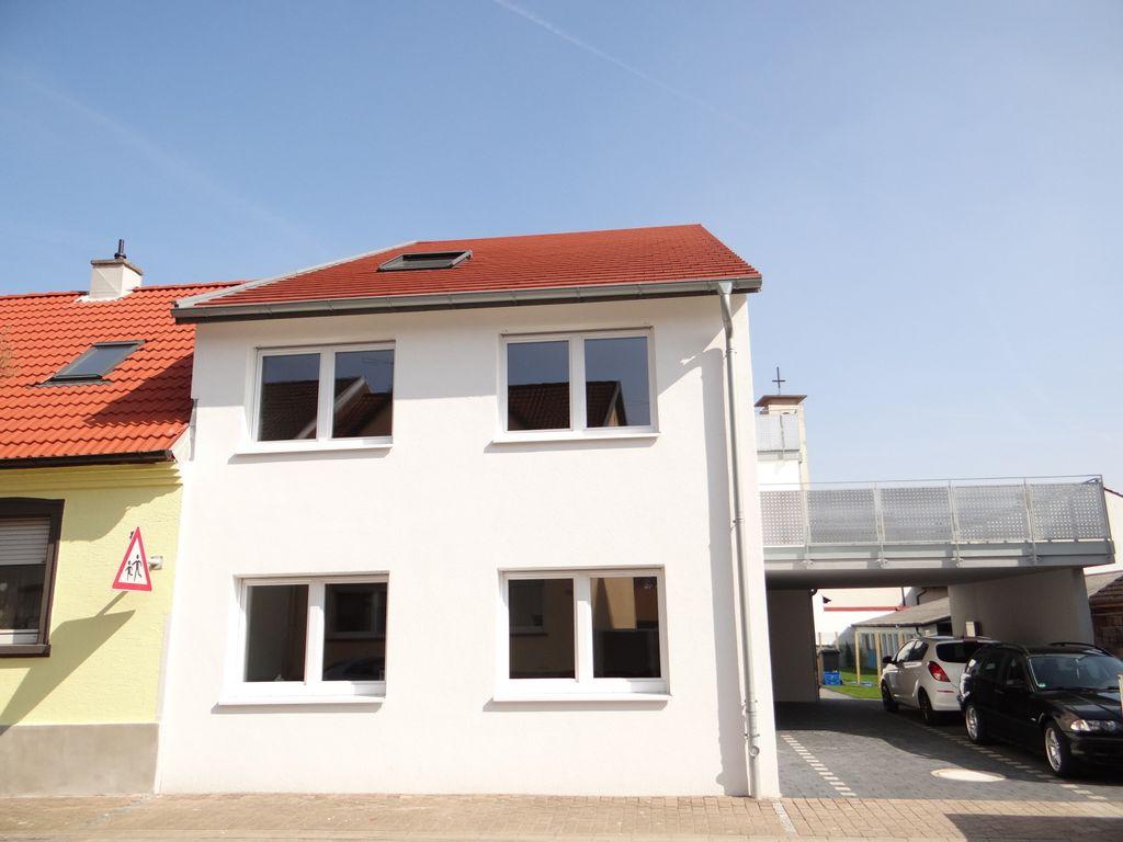 Neuwertige Wohnung mit eigenem Garten und passiver Kühlung