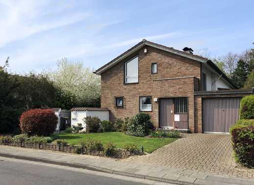 Einfamilienhaus mit Gewerberäumen/Einliegerwohnung im Obergeschoss