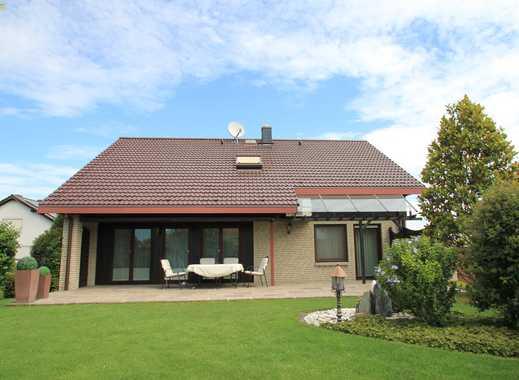Einfamilienhaus mit Einliegerwohnung in sonnenverwöhnter Ortsrandlage