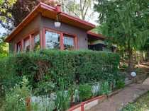 Gartengrundstück mit Bungalow und Garagen
