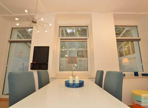 Freundliches Souterrain-Apartment mit großem Wintergarten