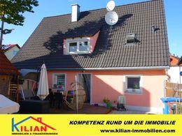 Einfamilienhaus und Terrasse