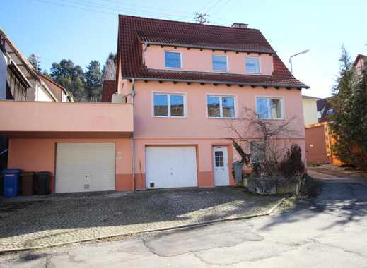 Einfamilienhaus mit grosser Sonnenterrasse, zwei Garagen und Kaminöfen