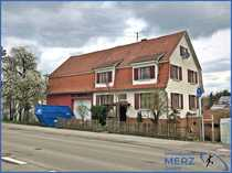 Einfamilienhaus mit angrenzender Scheune und
