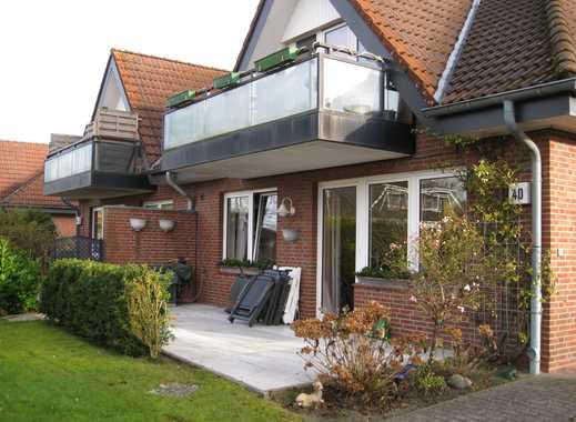Im Erdgeschoss mit Terrasse und kleinen Garten, Einbauküche und Fußbodenheizung