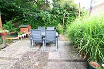 Komfortable Etagenwohnung mit Gartenanteil