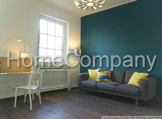 Modern and stylishly fitted apartment in a villa constructed pre-WWII, set in park-like grounds n...