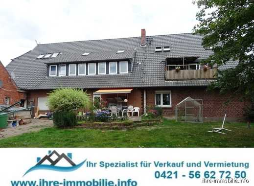 Weyhe-Kirchweyhe: Renditeobjekt mit Potential, MFH mit 5 WHG+7 Garagen u. Nebengebäude, auf 2.059 m²