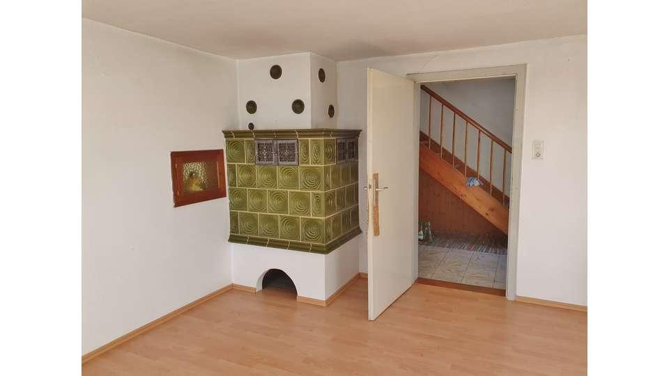 Wohnzimmer Kachelofen