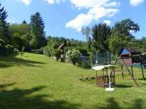 Burger Immobilien Gartengrundstück mit Holzhaus