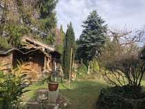 Älteres Zweifamilienhaus für Gartenliebhaber