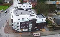 neuwertige 2-Zimmer-Wohnung mit 2 Balkonen, Einbauküche und Tiefgaragenstellplatz in zentraler Lage