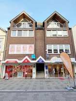 Grundsolides Wohn- und Geschäftshaus in