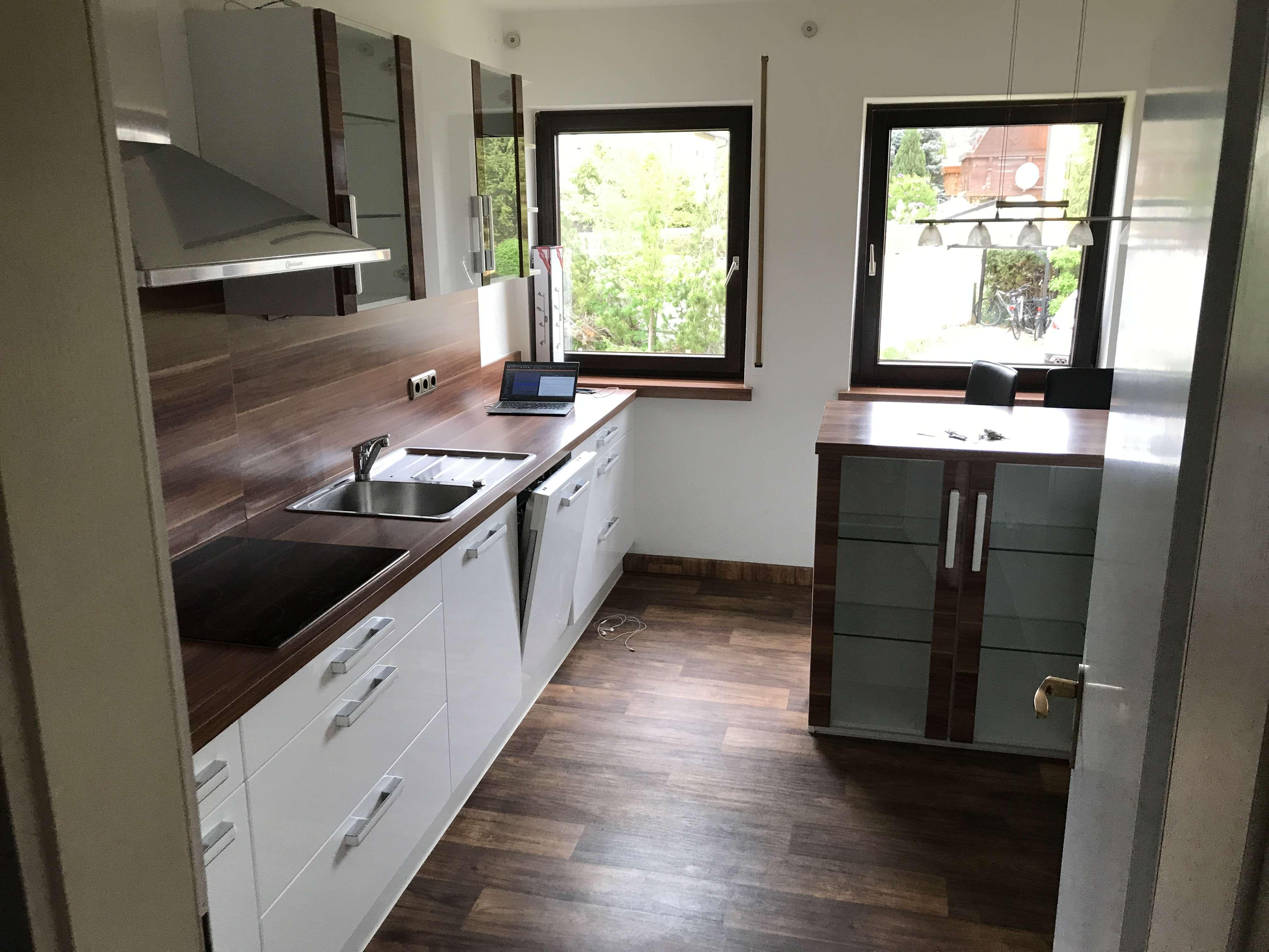 Gepflegte 3,5-Raum-Hochparterre-Wohnung mit Balkon und Einbauküche in Herzogenaurach in