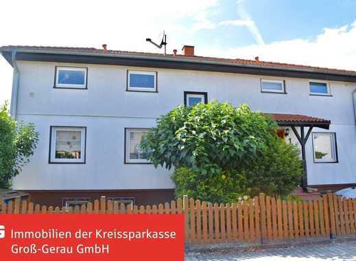 **Gepflegter Zweifamilienhaus Winkelbungalow auf großem Grundstück mit Kamin und Pool**