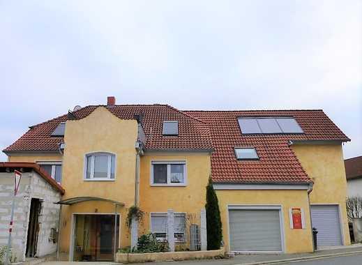 Zweifamilienhaus mit Gewerbeeinheit zur vielseitigen Nutzung