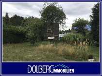 Grundstück mit Sanierungs- oder Abrissobjekt