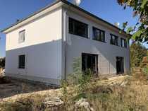 Bezugsfertige Doppelhaushälfte mit Carport