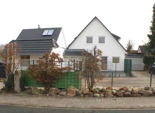 TOP SANIERT! Modernes, stilvolles Wohnen in Schwarzenbek: Extravagante 2,5-Zi.-Wohnung mit Garten