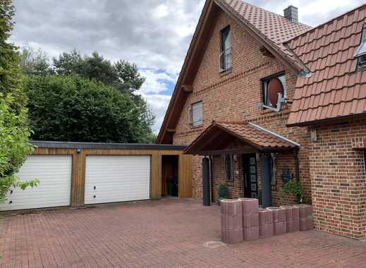 Einfamilienhaus mit Garten und Garage
