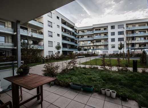 Modernes Zweizimmerappartement mit Terrasse und Garten.