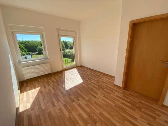 3-Raumwohnung mit Holzbalkon in beruhigter Lage
