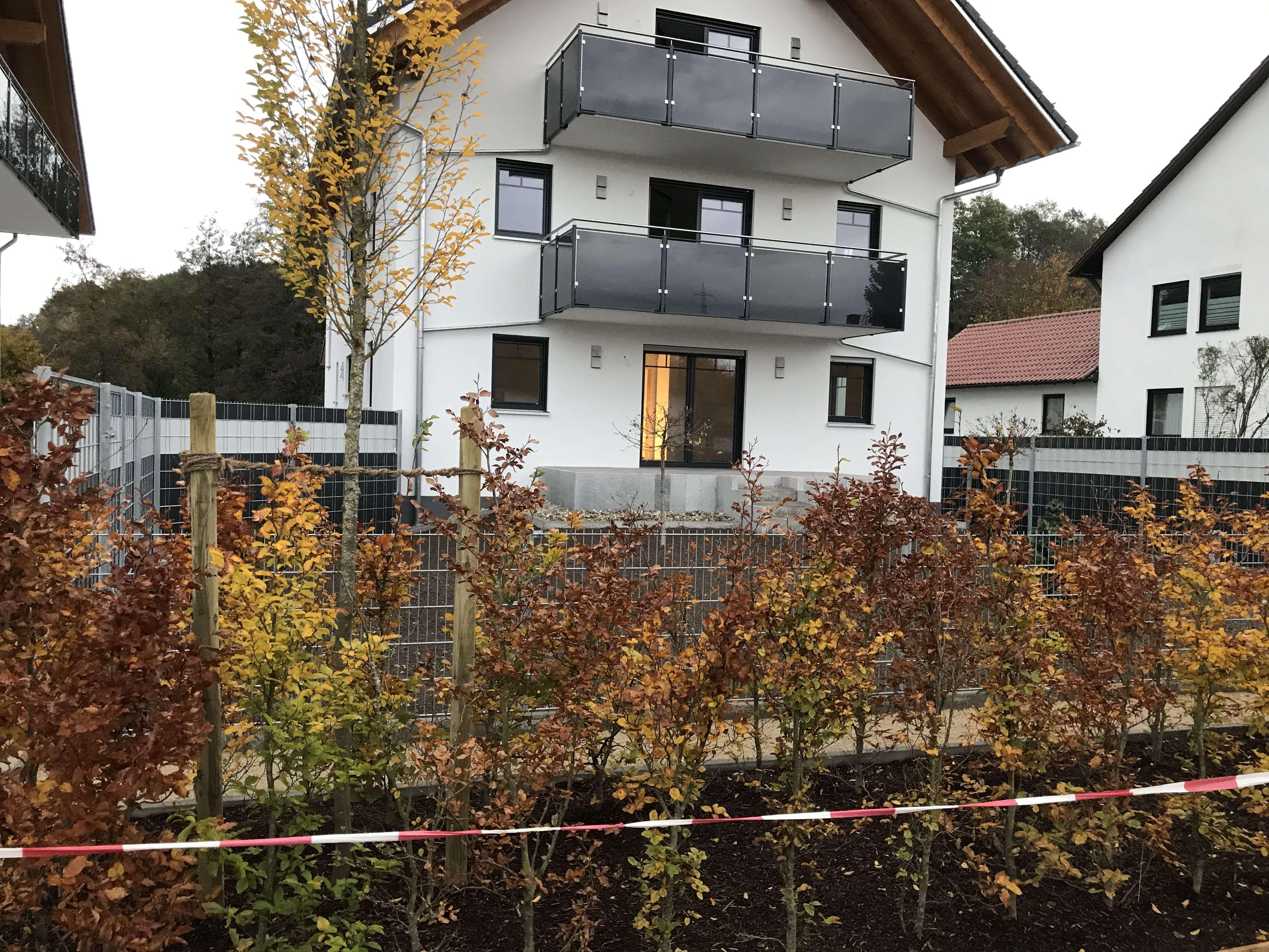 Erstbezug, Obergeschosswhng mit Einbauküche, großen Balkon und Gartenanteil auch möglich in