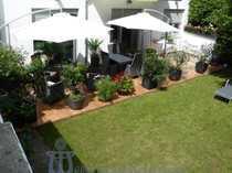 Luxuriöse Eigentumswohnung mit Gartenanteil in