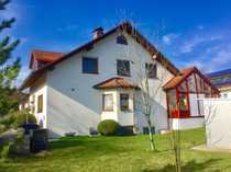 Große Doppelhaushälfte mit sonnigem Wintergarten