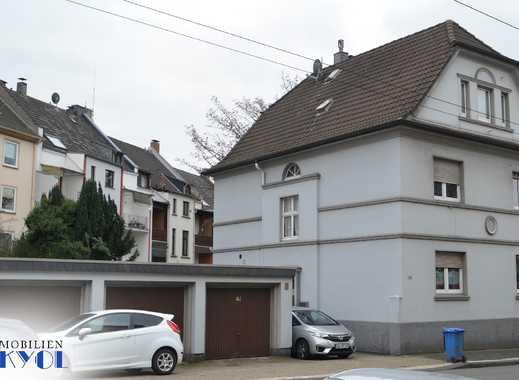 Kapitalanleger oder Selbstnutzer - AUFGEPASST -  MFH mit 3 Wohnungen, 4 Garagen und Garten