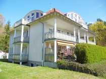 Wohnen im Grünen! Schöne 1-Zimmer-Wohnung mit Einbauküche, Balkon und Pkw-Stellplatz