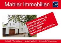 Modernisierungsbedürftige Doppelhaushälfte mit Garage in