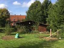 Baugrundstück voll erschlossen mit Blockhütte